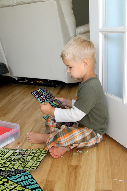Have your toddler punch out scrapbook letters to practice dexterity , learn more at www.momdot.com
