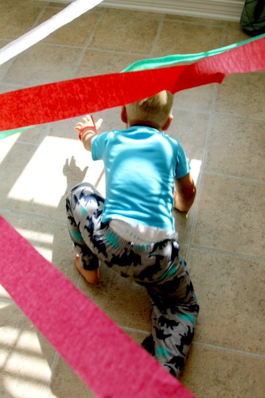 Create an at home laser spy experience in your home - toddler style!