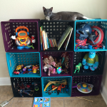 Create easy and inexpensive kid friendly cubby holes with $3 baskets and zip ties