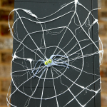 Create easy and flexible spider webs with hot glue for decoration, picture tutorial and fun Halloween Craft