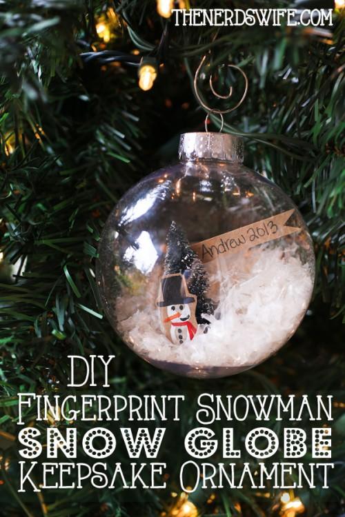 Fingerprint snowman snow globe ornament