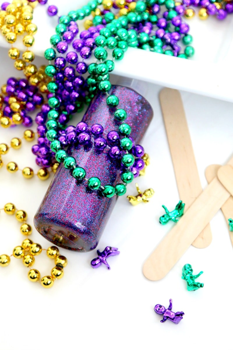 How to make Mardi Gras Slime : whether you celebrate mardi gras or not, get in the spirit of this fun Southern holiday by creating sensory green, gold, and purple slime