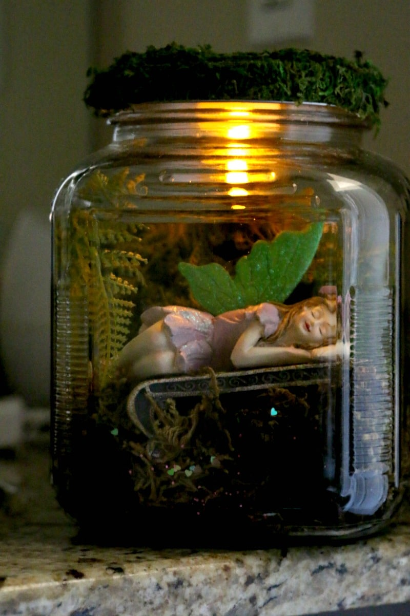 DIY Mason Jar Fairy Garden : adorable Fairy hidden away in a mason jar that can be used as a nightlight, decor, or put in the garden (and safe from rain!) , learn how to adopt a fairy for your garden today