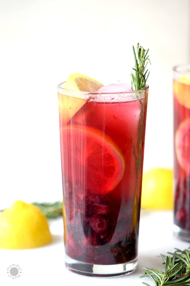 Cranberry & Rosemary Mocktail Jingle Juice, a delicious beverage that is perfectly fall!