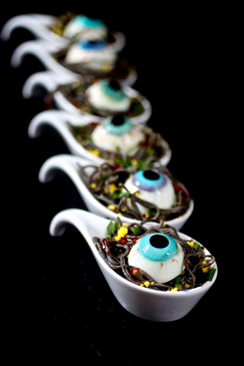 Black Bean Spaghetti Spoons with Deviled Eyes - Cringe worthy Halloween Night Dinner Recipe with realistic eyeballs (psst..eggs)
