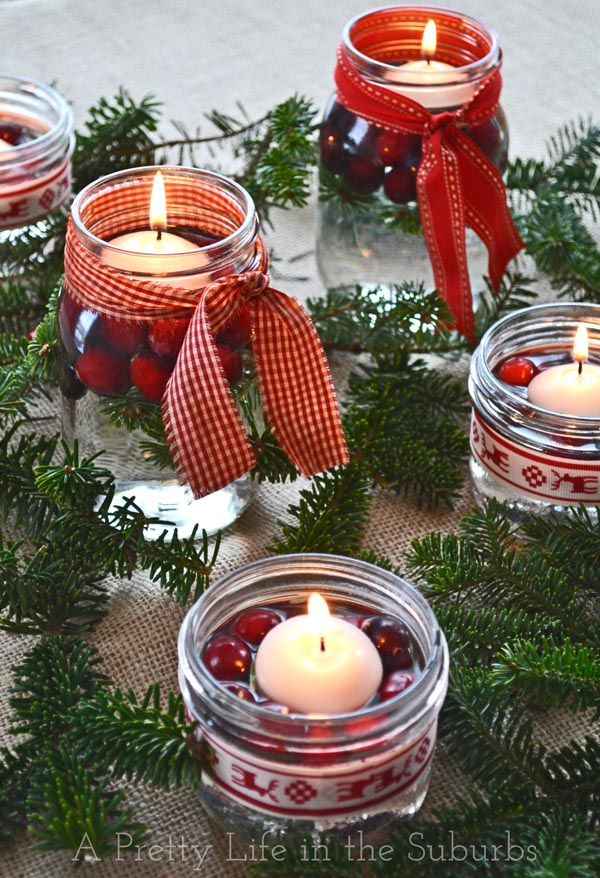 Cranberry christmas candles in mason jars