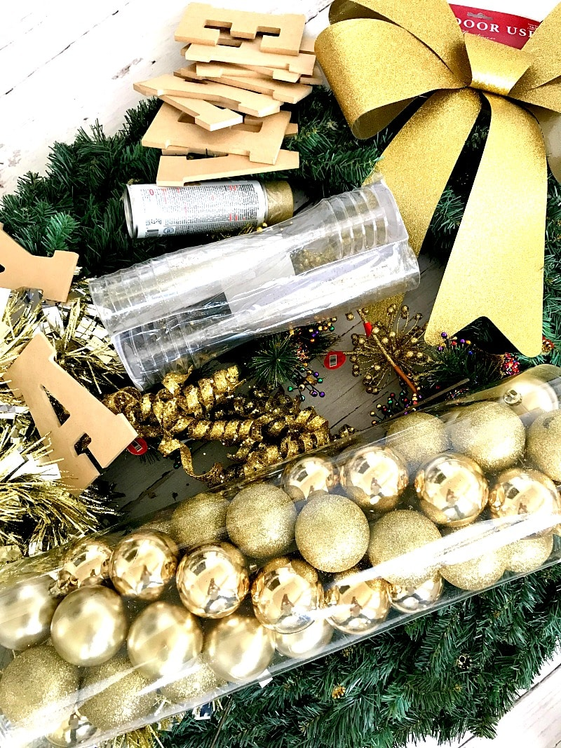New Year's Eve Wreath DIY : Bring in the New Year with your own Front Door Wreath- this one is also perfect for the inside, wine glasses and cider show everyone its a true celebration, tutorial