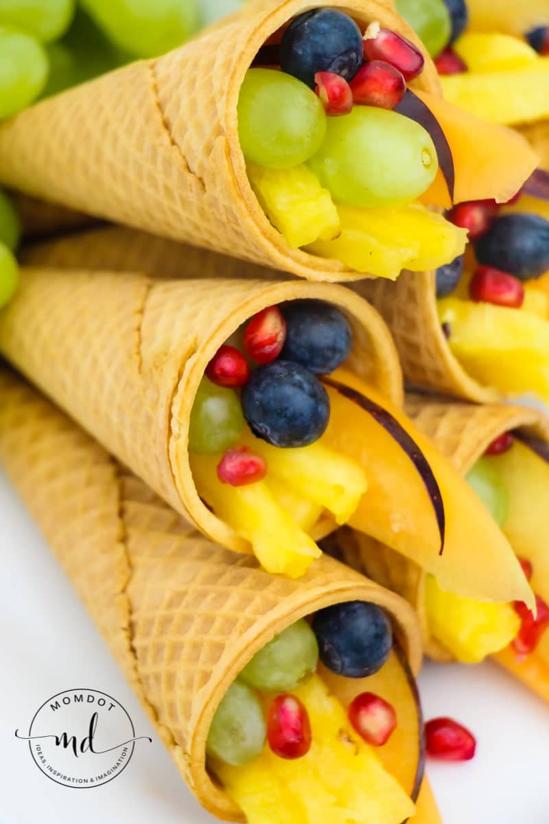 Cornucopia Centerpiece   Fruit Cornucopia with Sugar Cones   Kid Friendly Thanksgiving Idea #tutorial #recipe #thanksgivingrecipes #fruitideas #cornucopia #kidfriendly #crafting #holidays #fall