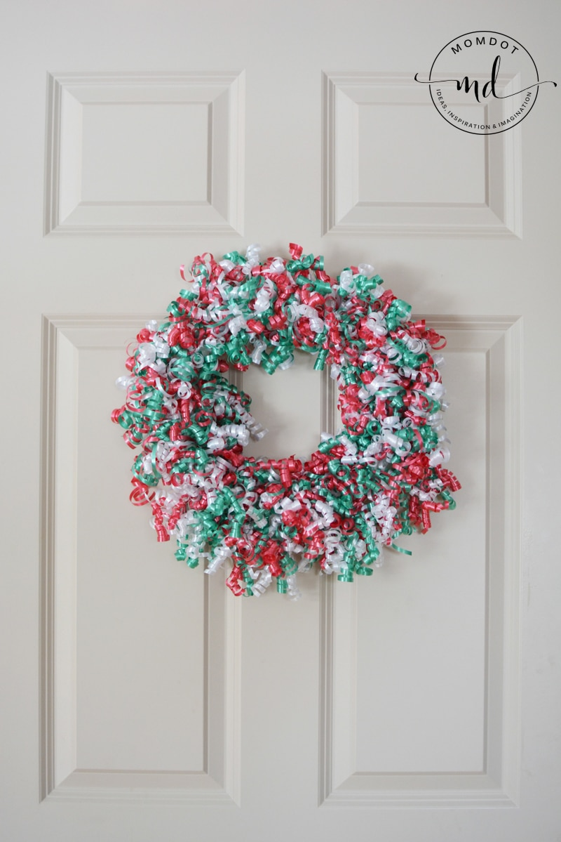 how to make a christmas ribbon wreath. Hang as desired.